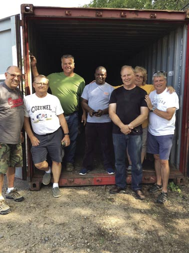 Volunteers packing a shipping container for Pathways to Hope Africa
